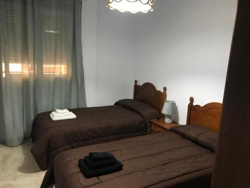 Katil atau katil-katil dalam bilik di Apartamentos Turisticos Arquimedes