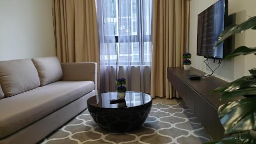A seating area at Kirei Suite 2BR @ I-Suite, I-City