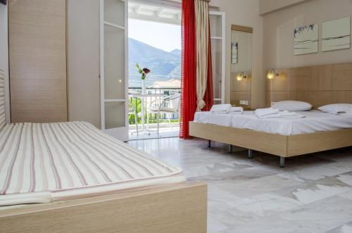 A bed or beds in a room at Happyland Hotel Apartments