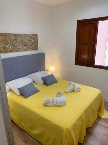 A bed or beds in a room at luxury apartment in the center of Seville