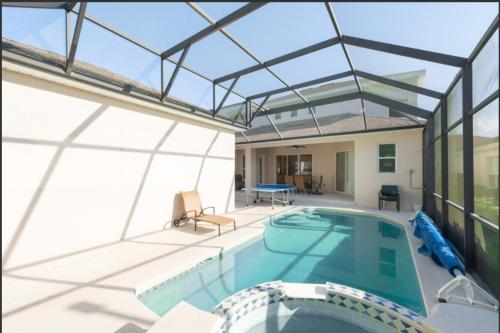 The swimming pool at or close to Orlando 5 beds 4 Baths Private Pool Family House - Close to Disney