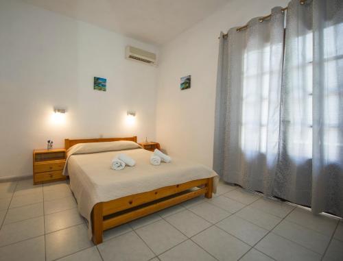Postel nebo postele na pokoji v ubytování Corfu Room