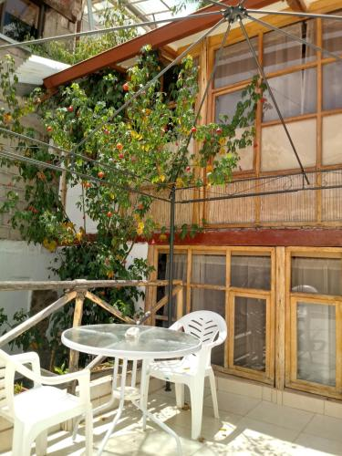 A balcony or terrace at Casa De Mama Cusco - The Treehouse