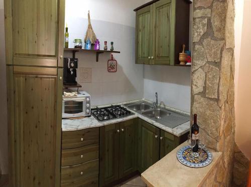 Kjøkken eller kjøkkenkrok på Appartamenti Monacò