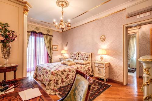 A bed or beds in a room at Domus Vittoria - The Luxury Quintessence