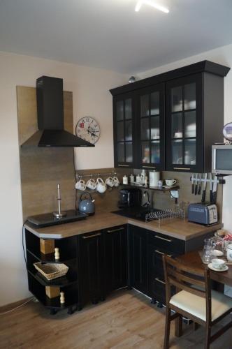 Kuchyňa alebo kuchynka v ubytovaní Apartmán v Rezidencii pri radnici