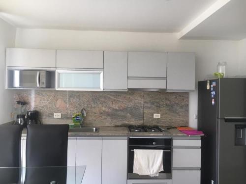 A kitchen or kitchenette at Edificio Antares