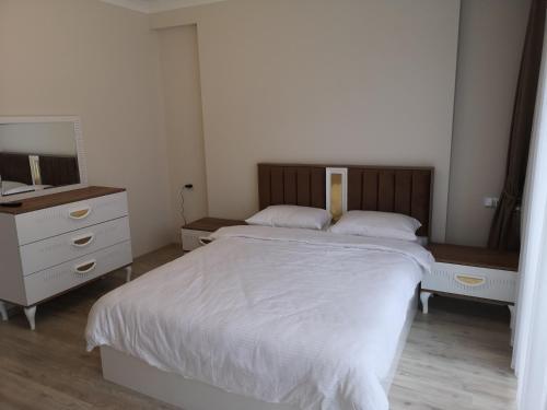 Lova arba lovos apgyvendinimo įstaigoje North Pearl Residence