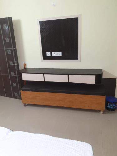 A television and/or entertainment center at Aarna Vatika Resort