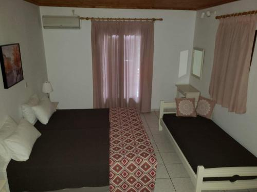 A bed or beds in a room at Marketos Apartments