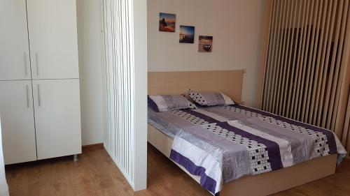 A bed or beds in a room at Diana Apartment