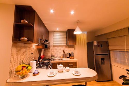 Una cocina o zona de cocina en KECHUASRESIDENCE