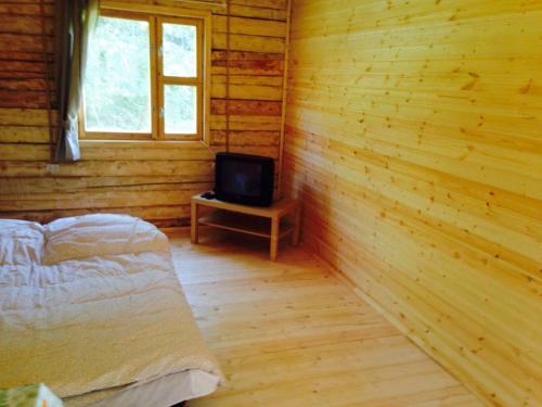 Кровать или кровати в номере Дом2