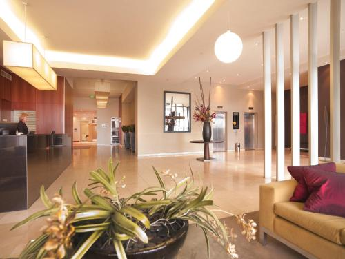 The lobby or reception area at Adina Apartment Hotel Melbourne Flinders Street