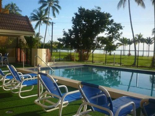 The swimming pool at or near Coral Towers Holiday Suites