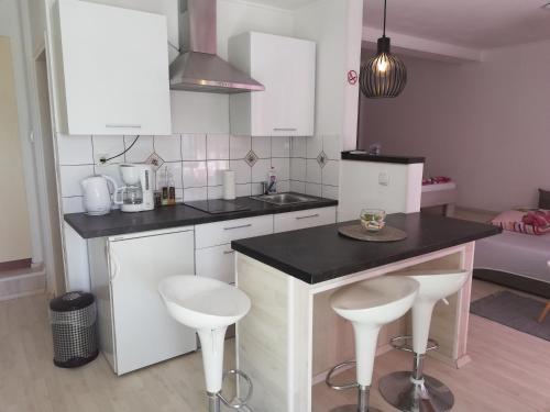 A kitchen or kitchenette at Ivana Apartment