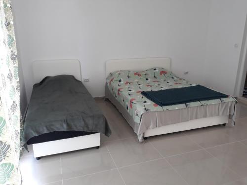 Postel nebo postele na pokoji v ubytování Zanjice1
