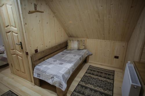 A bed or beds in a room at Еко дом