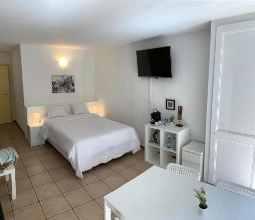 Ein Bett oder Betten in einem Zimmer der Unterkunft Résidence Neuchatel Vue Château