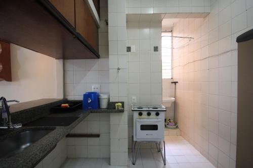 A kitchen or kitchenette at Dezembro 107