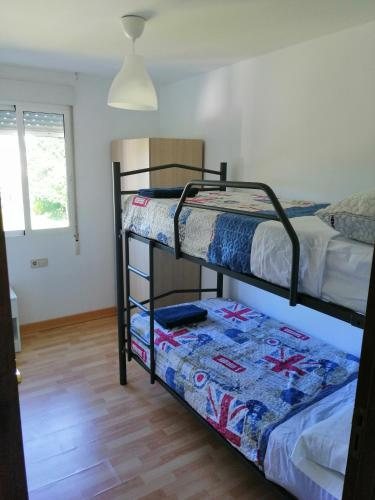 Litera o literas de una habitación en Teos Apartment