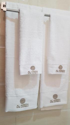 A bathroom at Al Areen Hotel Apartments