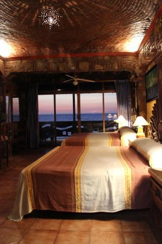 Cama o camas de una habitación en Hotel Casa Chips