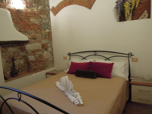 A bed or beds in a room at Corte Navari