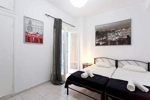 Кровать или кровати в номере Athens Smart Rooms 1