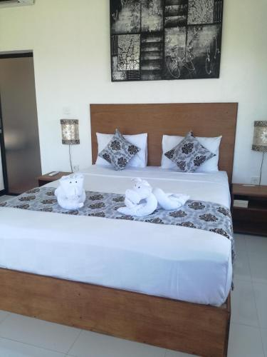 A bed or beds in a room at Hello Canggu Homestay