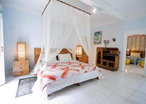 Cama ou camas em um quarto em Sayan Ridge Villa