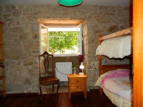 A bunk bed or bunk beds in a room at Casa da Costa Esteiro