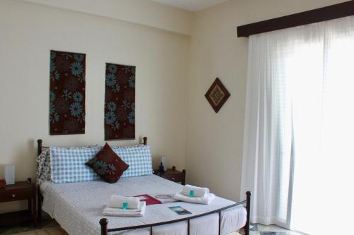 A bed or beds in a room at Aumkara
