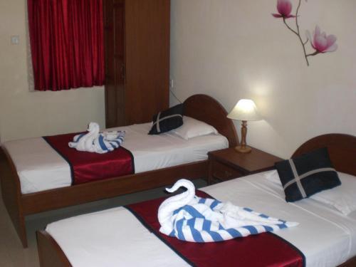 Кровать или кровати в номере A's Holiday Beach Resort