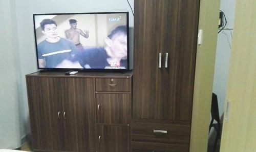 A television and/or entertainment center at marcelin's Place Tower 2 at Grace Resindeces Taguig