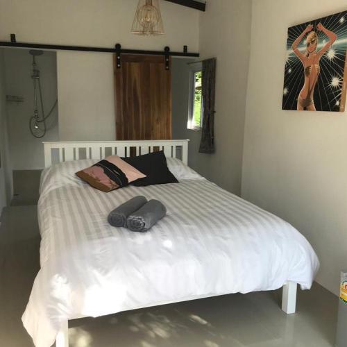 Ein Bett oder Betten in einem Zimmer der Unterkunft The Summer House Samui