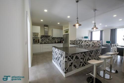 A kitchen or kitchenette at Atlanticus Guarida