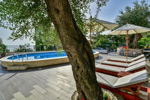 The swimming pool at or near Apartments Kentera