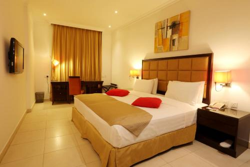 A bed or beds in a room at Corp Executive Doha Suites