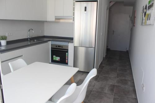 A kitchen or kitchenette at Torrevieja, 3 bedroom apartment