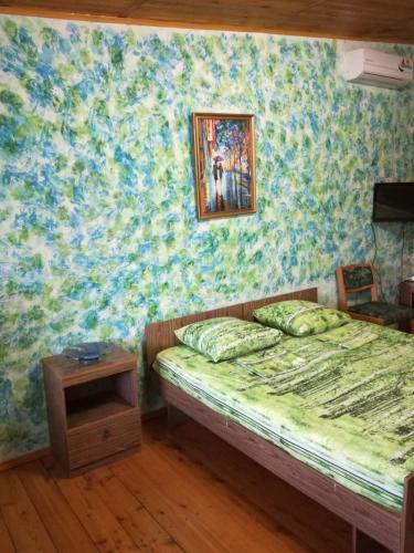 A bed or beds in a room at Guest house Baza otdyha Vodnik