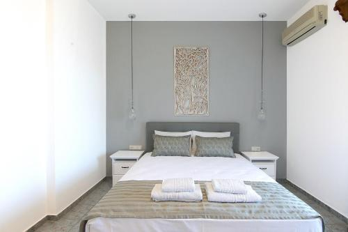 A bed or beds in a room at Olga Villa