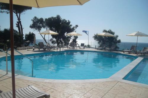 The swimming pool at or near Kastro Beach Hotel