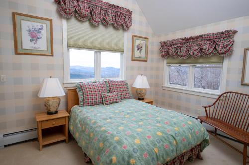 A bed or beds in a room at Solitude Village at Okemo