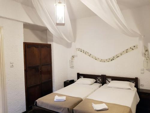 Un ou plusieurs lits dans un hébergement de l'établissement Anema By The Sea Guesthouse