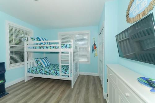 A bunk bed or bunk beds in a room at Bean Point Beachfront