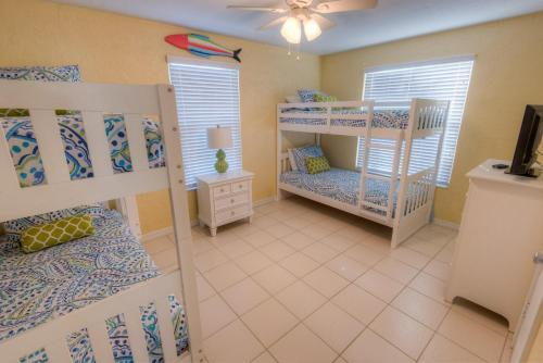 A bunk bed or bunk beds in a room at Shells and Sunshine