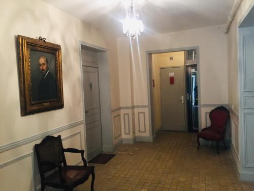 Coin salon dans l'établissement Appartements La Croix