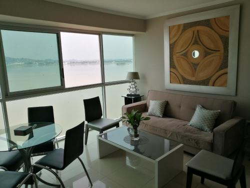 A seating area at River View suites Puerto Santa Ana