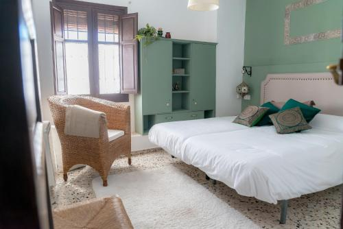A bed or beds in a room at BENDITA CASA